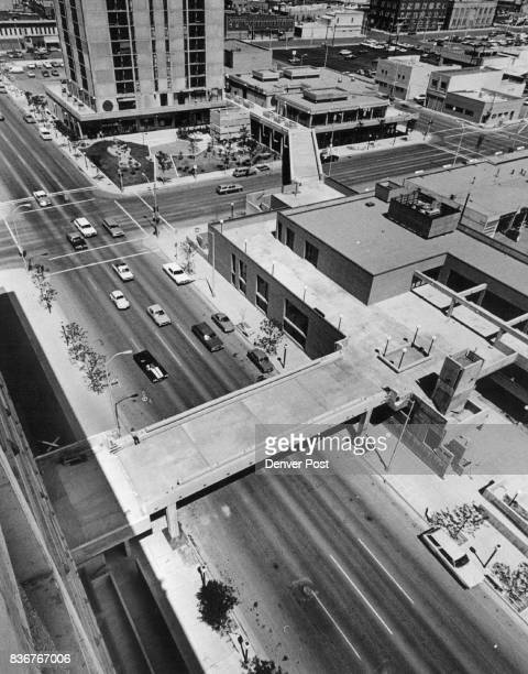 Dwellers of Sunset Park can stroll above Larimer en go across bridge in upper center of photo Street on bridge in foreground to shopping area the...