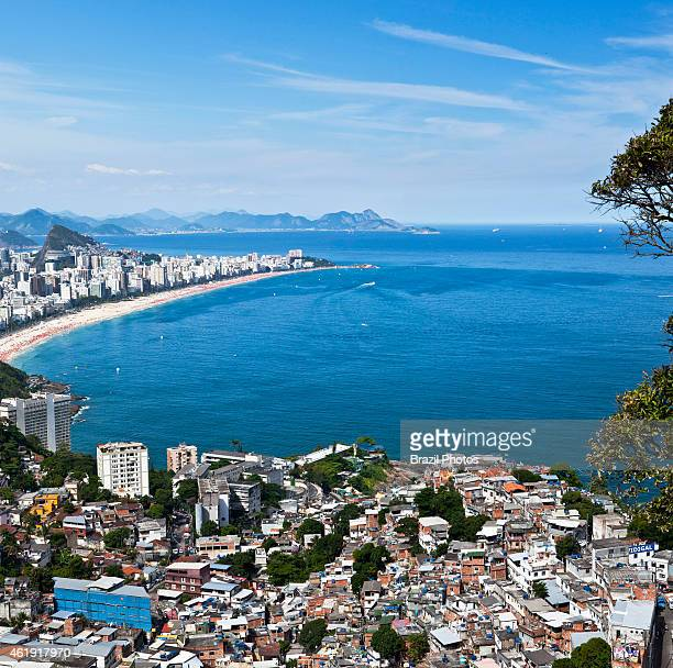 Dwelling conditions at Favela do Vidigal Ipanema and Leblon beaches in background the most affluent districts of the city