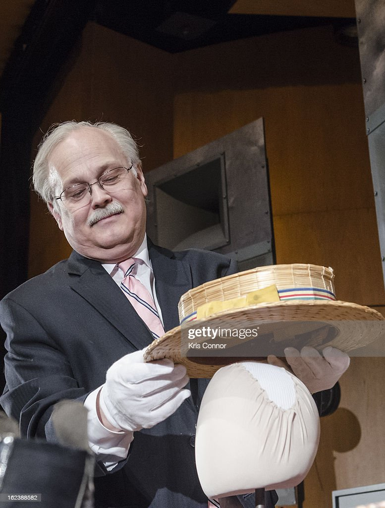 Dwight Blocker Bower places Joel Grey's hat on display during the 'Cabaret' Washington DC Screening Honoring Joel Grey at Smithsonian National Museum Of American History on February 22, 2013 in Washington, DC.