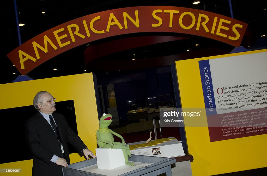 Dwight Blocker Bowers brings in Kermit the frog to the place of the Ruby Slippers from 'The Wizard Of Oz' which were taken off view from the Smithsonian's National Museum of American History to appear in the 'Hollywood Costume' exhibition at the Victoria and Albert Museum in London at National Museum Of American History on October 9, 2012 in Washington, DC.