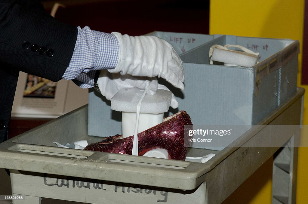 Dwight blocker Bowers places the Ruby Slippers from 'The Wizard Of Oz' in a shipping container to be taken off view from the Smithsonian's National Museum of American History to appear in the 'Hollywood Costume' exhibition at the Victoria and Albert Museum in London at National Museum Of American History on October 9, 2012 in Washington, DC.