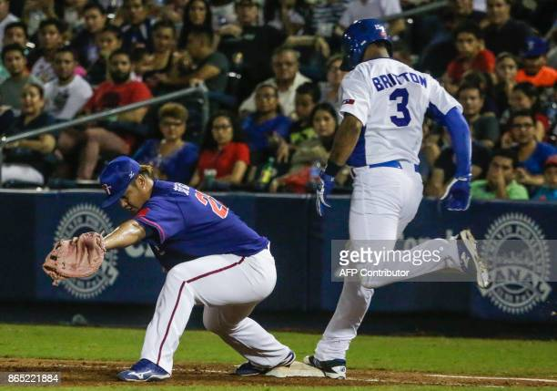 Dwight Britton of the Nicaraguan National Baseball Team is out in first base during a friendly game of the National Baseball Team of Nicaragua...