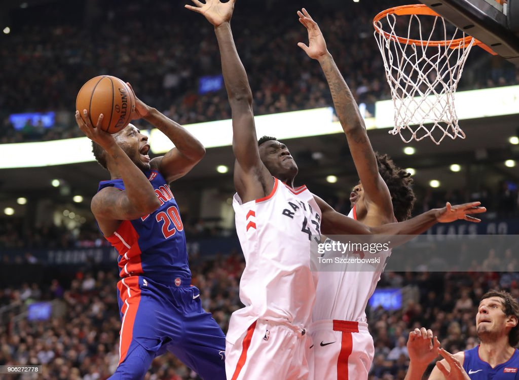 Dwight Buycks #20 of the Detroit Pistons goes to the basket against Pascal Siakam #43 of the Toronto Raptors at Air Canada Centre on January 17, 2018 in Toronto, Canada.