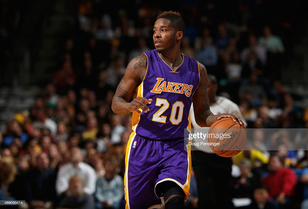 <a gi-track='captionPersonalityLinkClicked' href=/galleries/search?phrase=Dwight+Buycks&family=editorial&specificpeople=6699182 ng-click='$event.stopPropagation()'>Dwight Buycks</a> #20 of the Los Angeles Lakers controls the ball against the Denver Nuggets at Pepsi Center on April 8, 2015 in Denver, Colorado. The Nuggets defeated the Lakers 119-101.