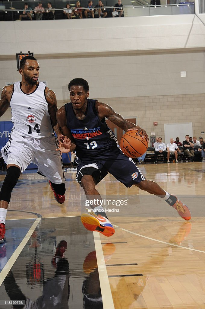 Dwight Buycks #12 of the Oklahoma City Thunder drives against <a gi-track='captionPersonalityLinkClicked' href=/galleries/search?phrase=Armon+Johnson&family=editorial&specificpeople=6530698 ng-click='$event.stopPropagation()'>Armon Johnson</a> #14 of the Detroit Pistons during the 2012 Air Tran Airways Orlando Pro Summer League on July 11, 2012 at Amway Center in Orlando, Florida.