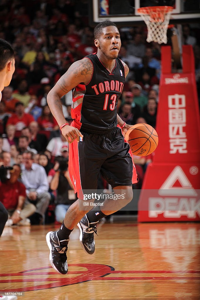 <a gi-track='captionPersonalityLinkClicked' href=/galleries/search?phrase=Dwight+Buycks&family=editorial&specificpeople=6699182 ng-click='$event.stopPropagation()'>Dwight Buycks</a> #13 of the Toronto Raptors drives the ball against the Houston Rockets on November 11, 2013 at the Toyota Center in Houston, Texas.