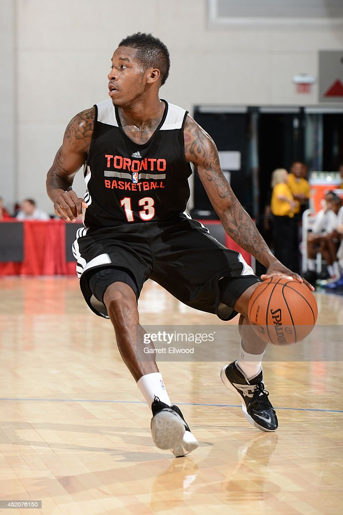 <a gi-track='captionPersonalityLinkClicked' href=/galleries/search?phrase=Dwight+Buycks&family=editorial&specificpeople=6699182 ng-click='$event.stopPropagation()'>Dwight Buycks</a> #13 of the Toronto Raptors handles the ball against the Denver Nuggets at the Samsung NBA Summer League 2014 on July 12, 2014 at the Cox Pavilion in Las Vegas, Nevada.