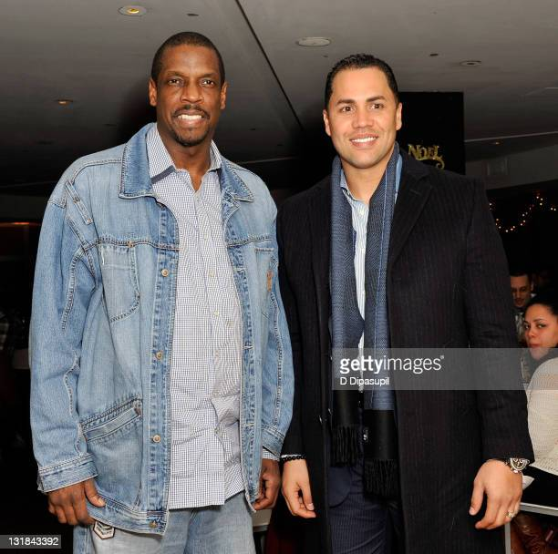Dwight 'Doc' Gooden and New York Mets player and Sofrito coowner Carlos Beltran at Sofrito on December 14 2010 in New York City