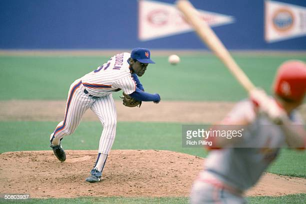 Dwight 'Doc' Gooden of the New York Mets delivers the pitch during a 1985 season game at Shea Stadium in Flushing New York