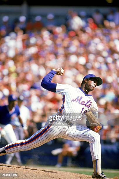 Dwight 'Doc' Gooden of the New York Mets pitches during a game against the Chicago Cubs at Shea Stadium in Flushing New York Gooden played for the...