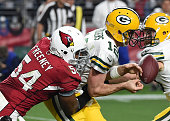 Dwight Freeney of the Arizona Cardinals causes a fumble while tackling Aaron Rodgers of the Green Bay Packers at University of Phoenix Stadium on...