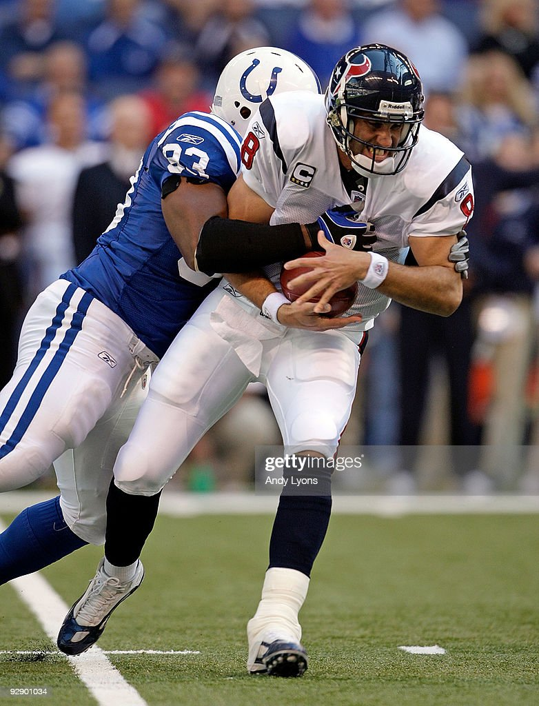 <a gi-track='captionPersonalityLinkClicked' href=/galleries/search?phrase=Dwight+Freeney&family=editorial&specificpeople=216500 ng-click='$event.stopPropagation()'>Dwight Freeney</a> #93 of the Indianapolis Colts sacks <a gi-track='captionPersonalityLinkClicked' href=/galleries/search?phrase=Matt+Schaub&family=editorial&specificpeople=2210847 ng-click='$event.stopPropagation()'>Matt Schaub</a> #8 of the Houston Texans during the NFL game at Lucas Oil Stadium on November 8, 2009 in Indianapolis, Indiana. The Colts won 20-17.