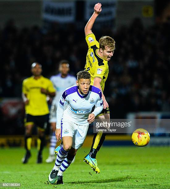 Dwight Gale of Newcastle United beats Damien McCrory of Burton Albion for the ball during the Sky Bet Championship match between Burton Albion and...