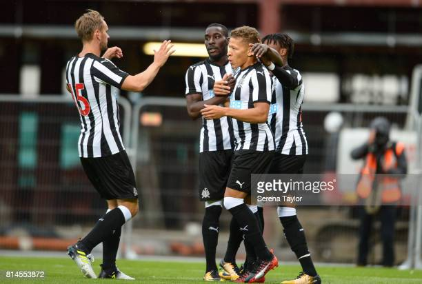 Dwight Gale of Newcastle United celebrates with teammates seen LR Siem de Jong Massadio Haidara and Rolando Aarons after scoring the opening goal...