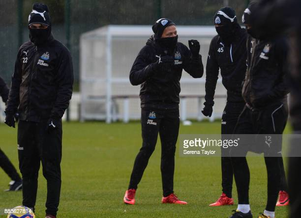 Dwight Gale of Newcastle United chats with Jonjo Shelvey during the Newcastle United training session at the Newcastle United Training Centre on...