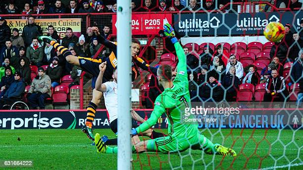 Dwight Gale of Newcastle United scores the opening goal past Brentford Football Club Goalkeeper Daniel Bentley during the Championship Match between...