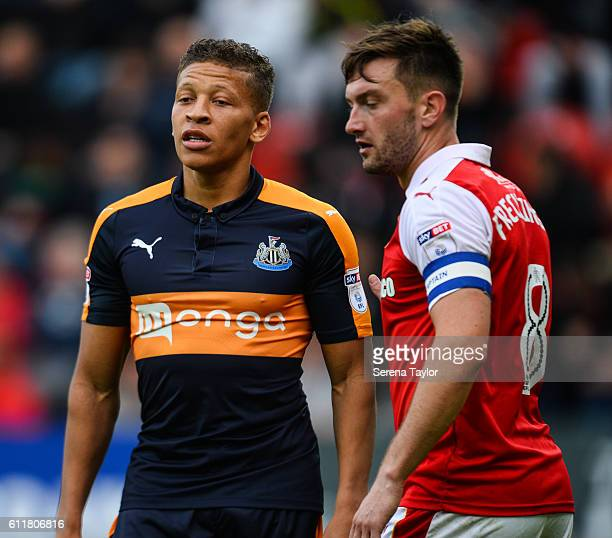 Dwight Gale of Newcastle United stands next to Lee Frecklington of Rotherham United during the Sky Bet Championship match between Rotherham United...