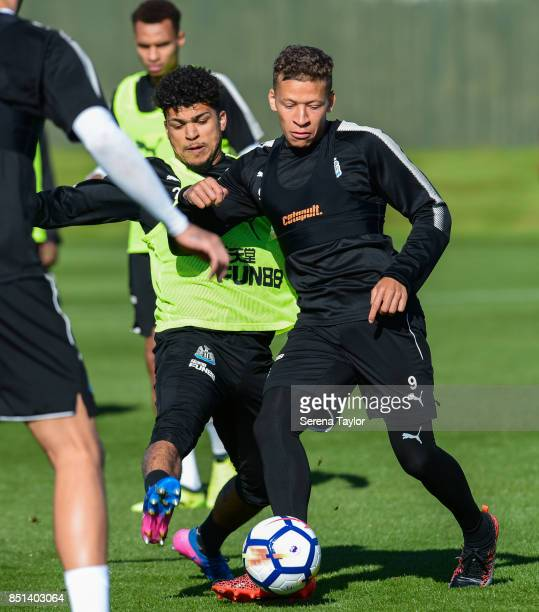 Dwight Gayle and DeAndre Yedlin jostle for the ball during the Newcastle United Training session at the Newcastle United Training Centre on September...