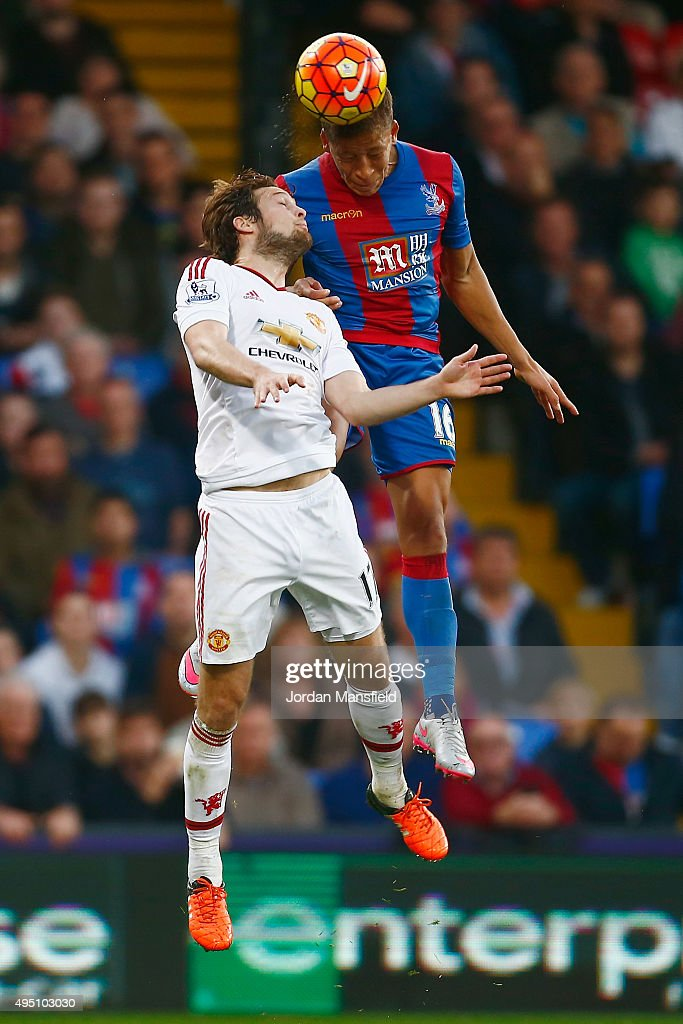 Dwight Gayle of Crystal Palace and Daley Blind of Manchester United compete for the ball during the Barclays Premier League match between Crystal Palace and Manchester United at Selhurst Park on October 31, 2015 in London, England.