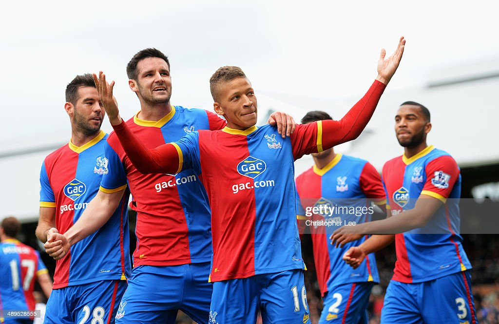 Dwight Gayle of Crystal Palace celebrates scoring his second goal with team mates during the Barclays Premier League match between Fulham and Crystal Palace at Craven Cottage on May 11, 2014 in London, England.