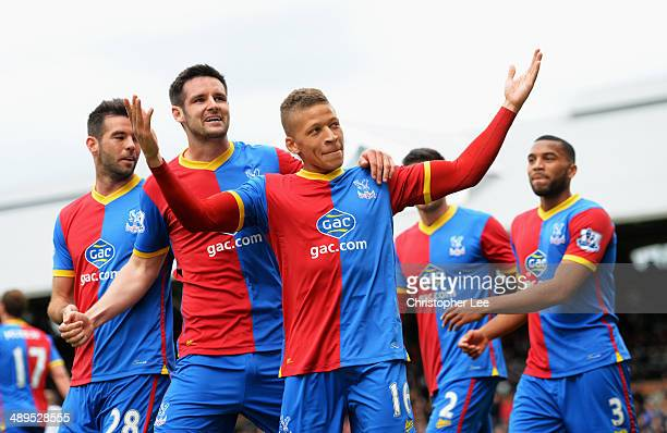 Dwight Gayle of Crystal Palace celebrates scoring his second goal with team mates during the Barclays Premier League match between Fulham and Crystal...