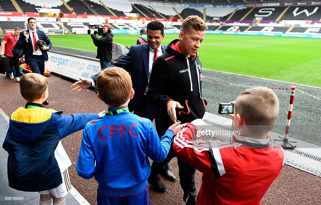 <a gi-track='captionPersonalityLinkClicked' href=/galleries/search?phrase=Dwight+Gayle&family=editorial&specificpeople=9764909 ng-click='$event.stopPropagation()'>Dwight Gayle</a> (R) of Crystal Palace greets fans on arrival at the stadium prior to the Barclays Premier League match between Swansea City and Crystal Palace at the Libery Stadium on February 6, 2016 in Swansea, Wales.