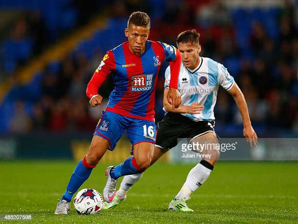 Dwight Gayle of Crystal Palace holds off Matthew Sadler of Shrewsbury Town during the Capital One Cup second round match between Crystal Palace and...
