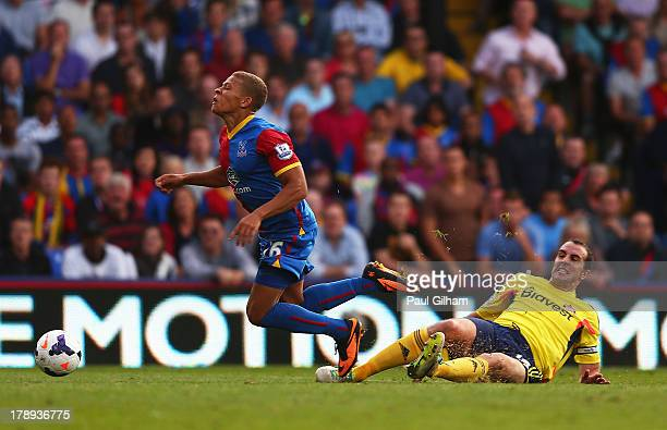 Dwight Gayle of Crystal Palace is brought down in the penalty area by John O'Shea of Sunderland leading to a penalty and his sending off during the...