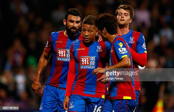 Dwight Gayle of Crystal Palace is congratulated by his team mates after scoring his side's first goal from the penatly spot during the Capital One...
