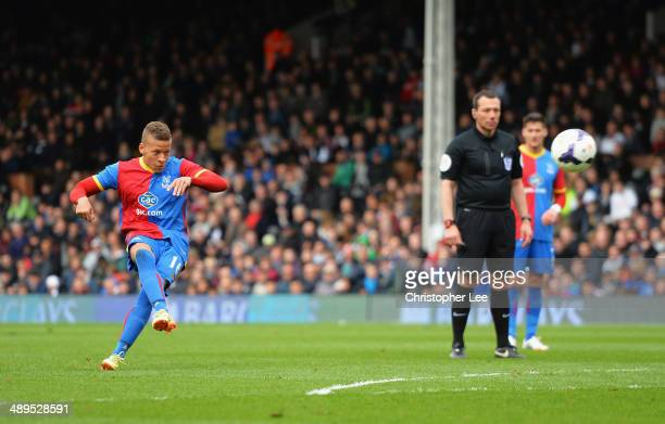 Dwight Gayle of Crystal Palace scores his second goal with a free kick during the Barclays Premier League match between Fulham and Crystal Palace at...