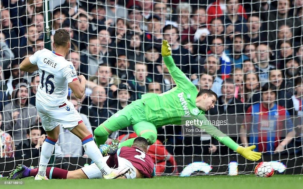 Dwight Gayle of Crystal Palace scores his team's second goal past Adrian of West Ham United during the Barclays Premier League match between West Ham United and Crystal Palace at the Boleyn Ground on April 2, 2016 in London, England.