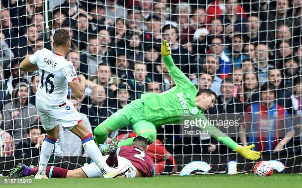 Dwight Gayle of Crystal Palace scores his team's second goal past Adrian of West Ham United during the Barclays Premier League match between West Ham...