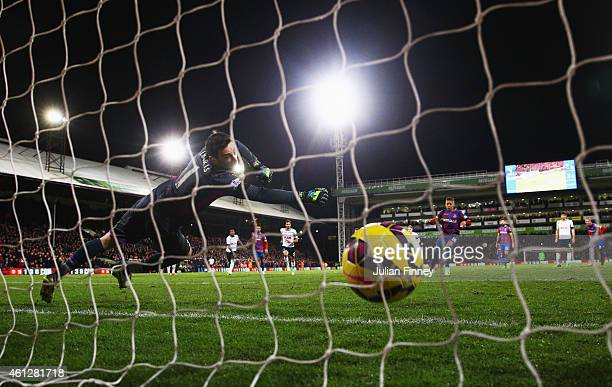 Dwight Gayle of Crystal Palace scores their first and equalising goal from a penalty past goalkeeper Hugo Lloris of Spurs during the Barclays Premier...