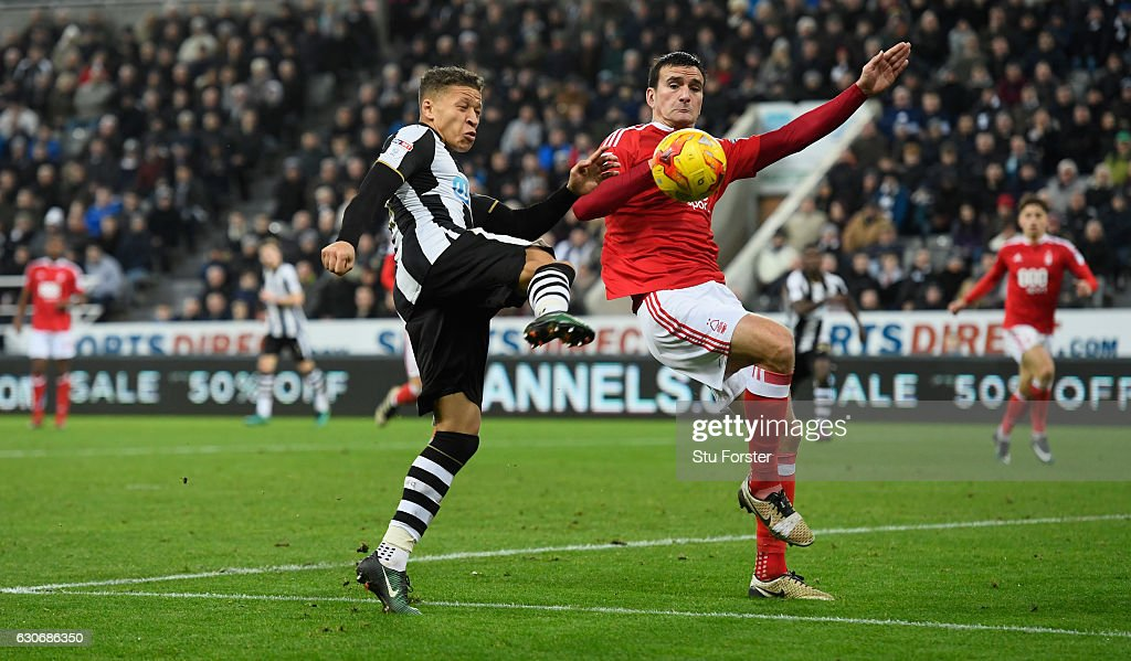 Dwight Gayle of Newcastle (l) scores the second Newcastle goal during the Sky Bet Championship match between Newcastle United and Nottingham Forest at St James' Park on December 30, 2016 in Newcastle upon Tyne, England.