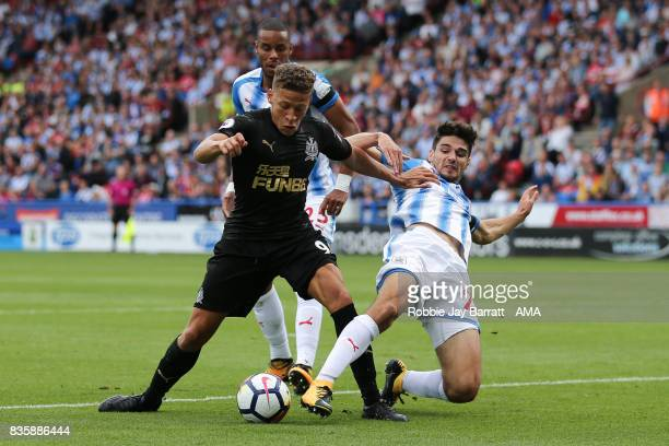 Dwight Gayle of Newcastle United and Christopher Schindler of Huddersfield Town during the Premier League match between Huddersfield Town and...