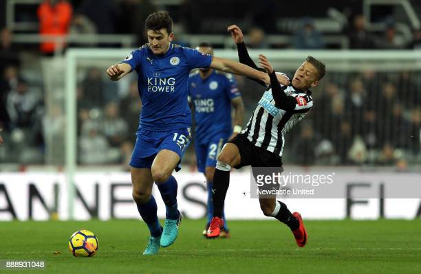 Dwight Gayle of Newcastle United and Harry Maguire of Leicester City during the Premier League match between Newcastle United and Leicester City at...