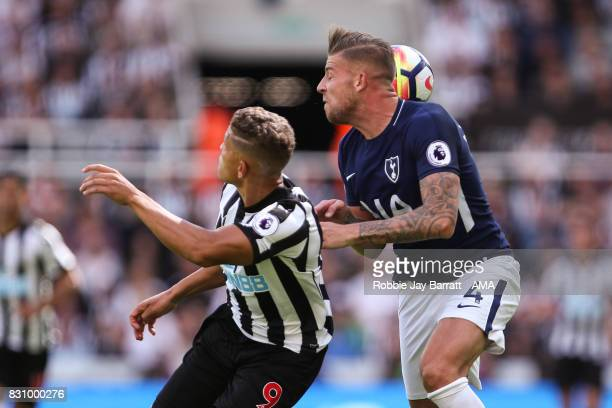 /Dwight Gayle of Newcastle United and Toby Alderweireld of Tottenham Hotspur during the Premier League match between Newcastle United and Tottenham...
