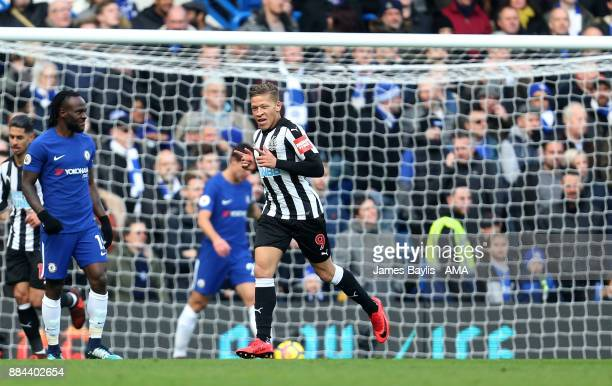 Dwight Gayle of Newcastle United celebrates after scoring a goal to make it 01 during the Premier League match between Chelsea and Newcastle United...
