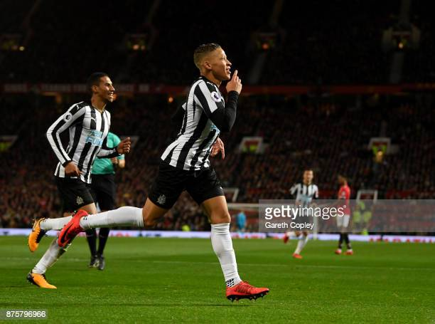 Dwight Gayle of Newcastle United celebrates with team mates after scoring his sides first goal during the Premier League match between Manchester...