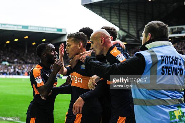 Dwight Gayle of Newcastle United celebrates with teammates after scoring the opening goal during the Sky Bet Championship Match between Leeds United...