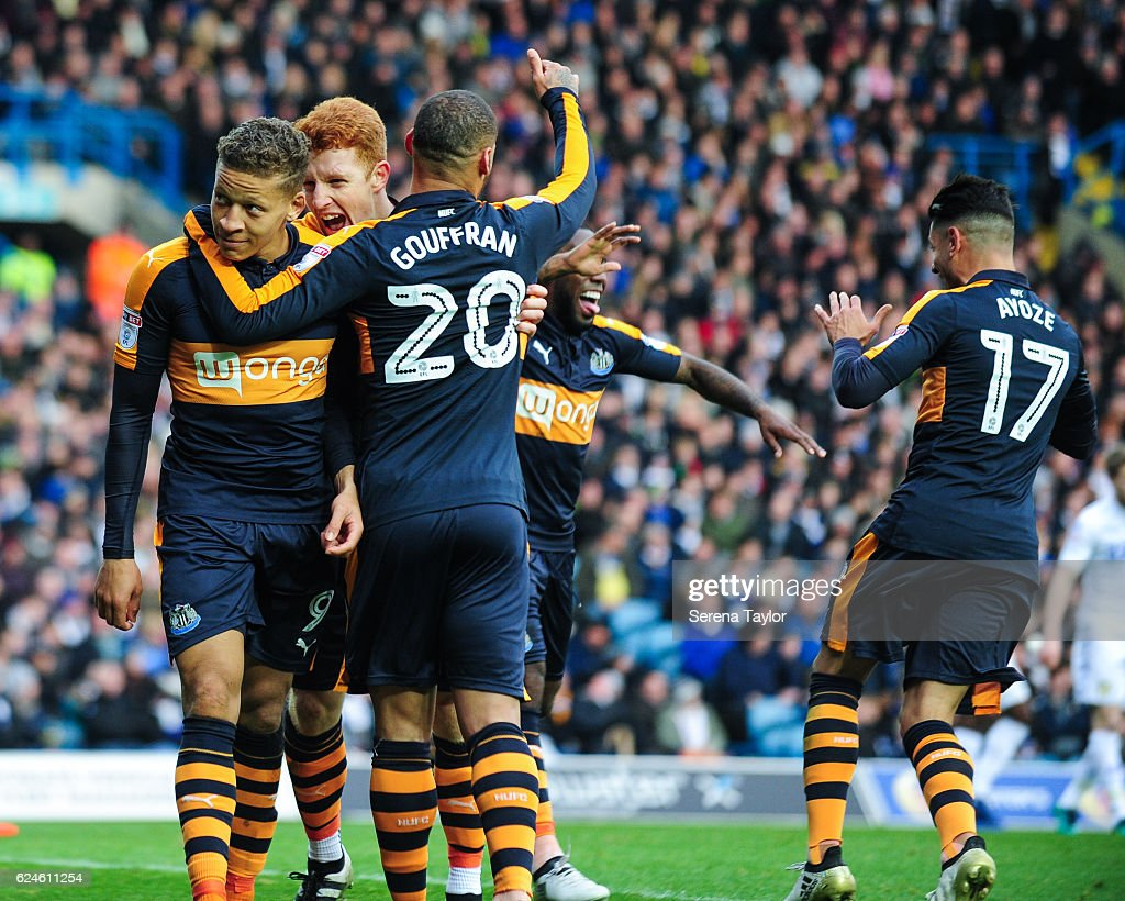 Dwight Gayle of Newcastle United (L) celebrates with teammates Jack Colback (C) and Yoan Gouffran (R) after scoring Newcastles second goal during the Sky Bet Championship Match between Leeds United and Newcastle United at Elland Road on November 20, 2016 in London, England.