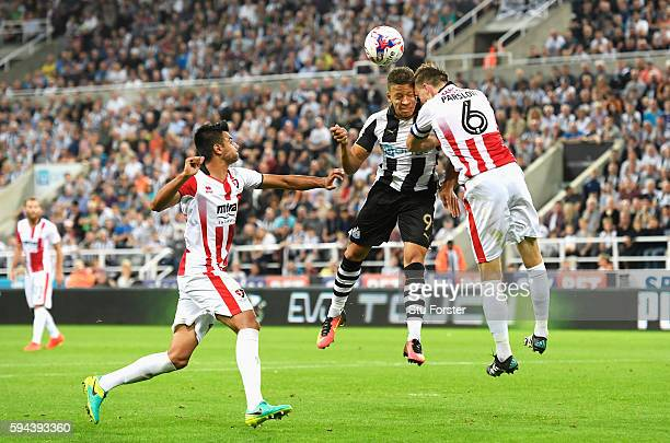 Dwight Gayle of Newcastle United clashes with Daniel Parslow of Cheltenham Town resulting in an injury during the EFL Cup second round match between...