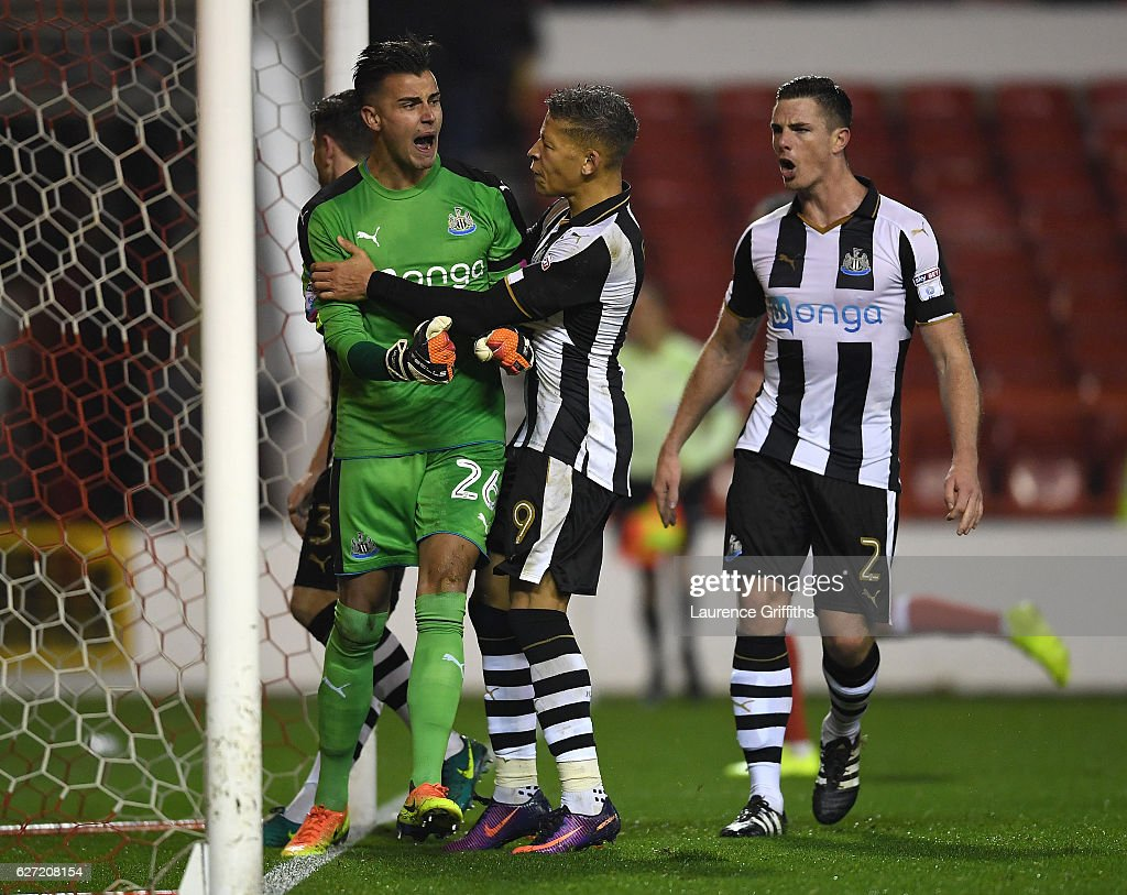 Dwight Gayle of Newcastle United congratulates Karl Darlow on saving a penalty of Nicklas Bendtner of Nottingham Forest during the Sky Bet Championship match between Nottingham Forest and Newcastle United at City Ground on December 2, 2016 in Nottingham, England.