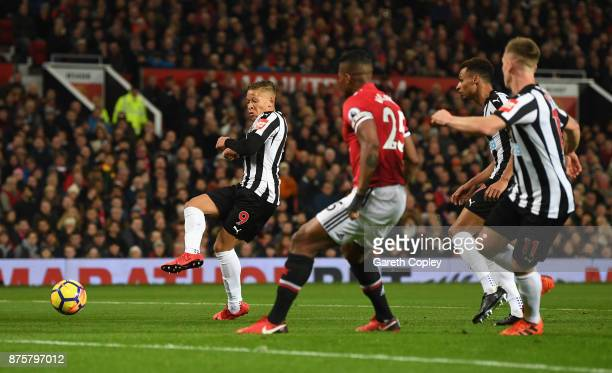 Dwight Gayle of Newcastle United scores his sides first goal during the Premier League match between Manchester United and Newcastle United at Old...