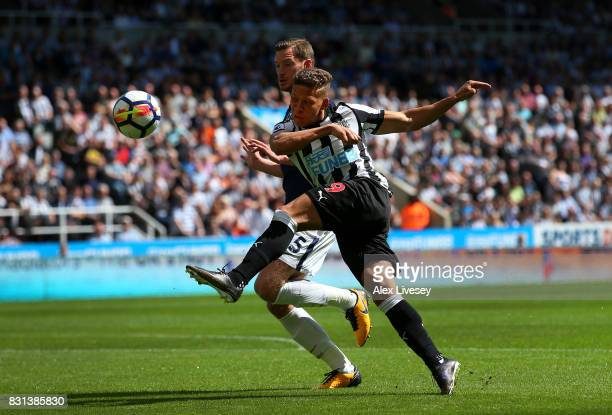 Dwight Gayle of Newcastle United shoots ahead of Jan Vertonghen of Tottenham Hotspur during the Premier League match between Newcastle United and...