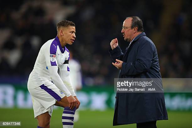 Dwight Gayle of Newcastle United talks to Rafael Benitez Manager of Newcastle United during the at EFL Cup QuarterFinal match between Hull City and...