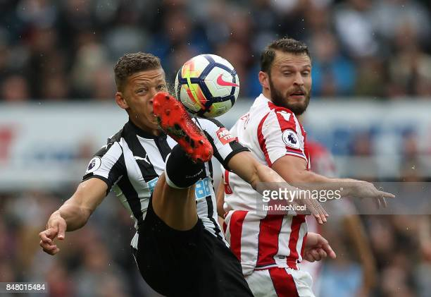 Dwight Gayle of Newcastle United vies with Erik Pieters of Stoke City during the Premier League match between Newcastle United and Stoke City at St...
