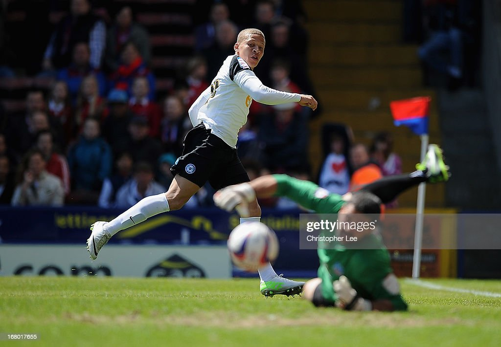 Dwight Gayle of Peterborough has his shot saved by Julian Speroni of Palace during the npower Championship match between Crystal Palace and Peterborough United at Selhurst Park on May 04, 2013 in London, England.