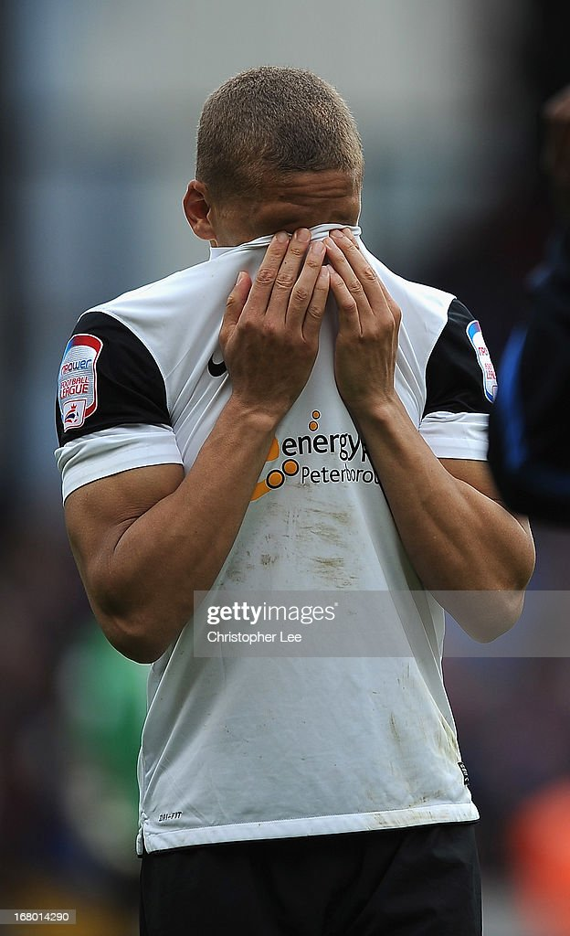 Dwight Gayle of Peterborough looks dejected after they are relegated during the npower Championship match between Crystal Palace and Peterborough United at Selhurst Park on May 04, 2013 in London, England.