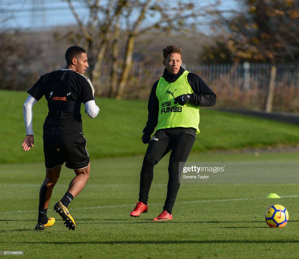 Dwight Gayle (R) passes the ball during the Newcastle United Training session at the Newcastle Untied Training Centre on November 9, 2017 in Newcastle upon Tyne, England.